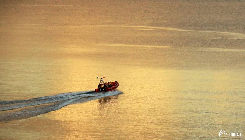 Looe RNLI Atlantic 85 launching at sunset